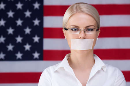 taped: Young woman with mouth taped