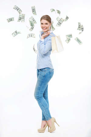 flying money: Young girl with flying money