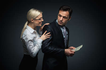 Businessman and businesswoman with money photo