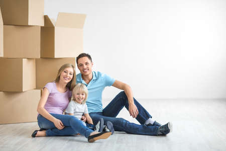 cardboard house: Family with a child at home Stock Photo