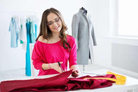 Young fashion designer at work photo