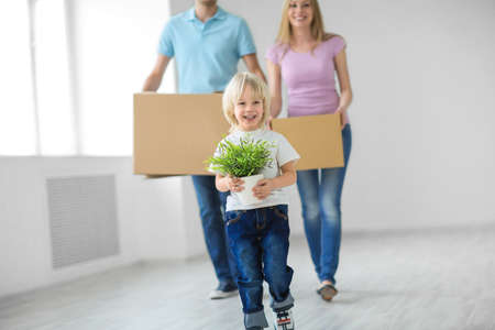 new home: Young family with a child move