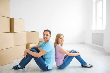 Young couple at home with boxes photo