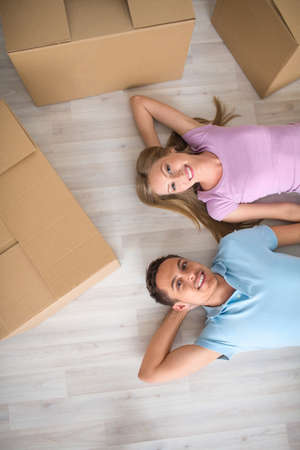 Young couple with boxes on the floor photo