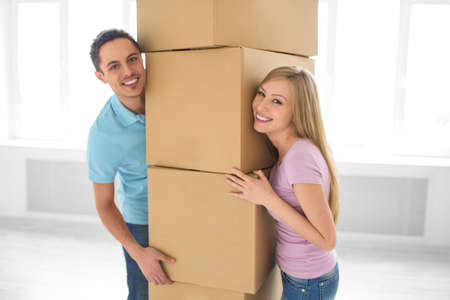 Young couple with boxes at home photo