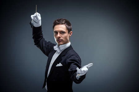 Young conductor in a tuxedo Stock fotó