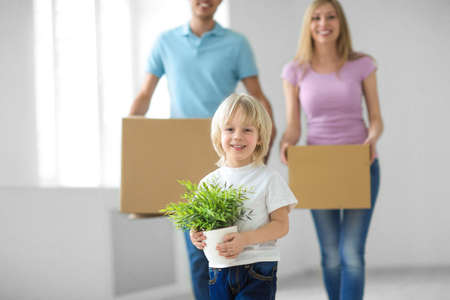 Family with boxes at home photo