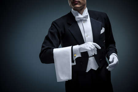 white glove: Young man in a tuxedo