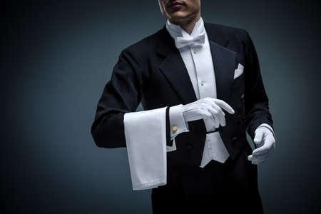 butler: Young man in a tuxedo