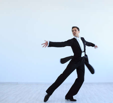 Dancer in a tuxedo indoors photo