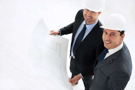 Businessman in helmet with the project photo