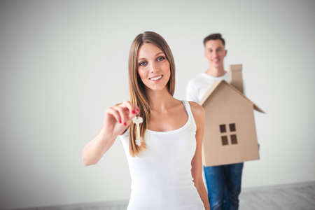 Couple with the keys of new house Stock Photo