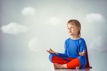 Boy in suit  in lotus position