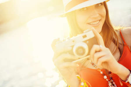 people travelling: Young attractive girl with a camera Stock Photo