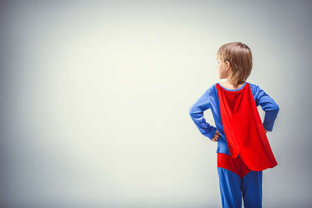 Little superman in a raincoat