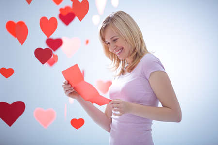 Young attractive girl with a letter and hearts photo