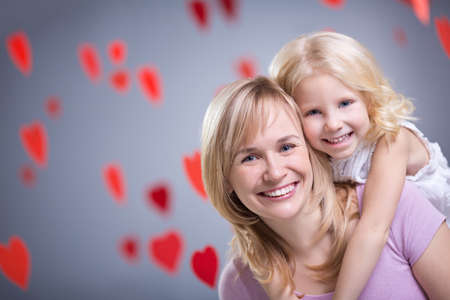 Mother and daughter with hearts photo