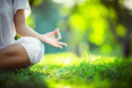 relaxing: Yoga in the park Stock Photo