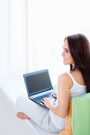 Young attractive girl with a laptop photo
