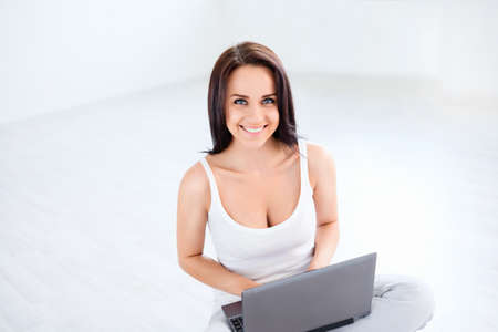 Young girl with laptop indoors photo