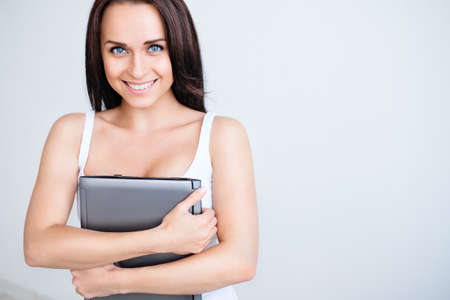 Beautiful girl with a laptop indoors photo