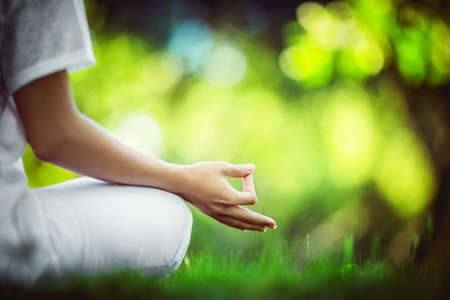 Woman in lotus pose outdoors