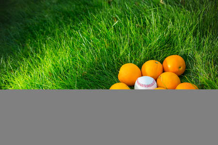 stillife: Oranges and ball on grass Stock Photo