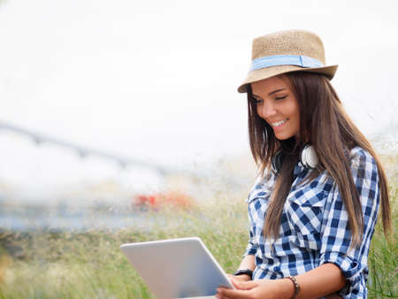 Young woman with a laptop outdoors