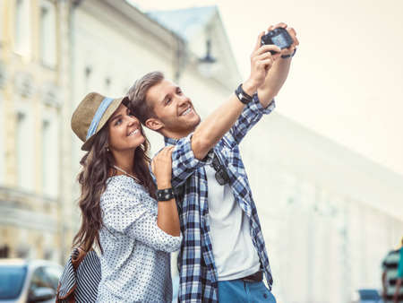 people  camera: Young couple making selfie