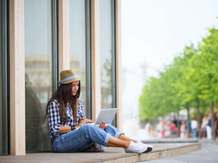 laptop: Young girl with a laptop Stock Photo