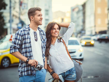 Smiling young couple in the city Reklamní fotografie - 39098233