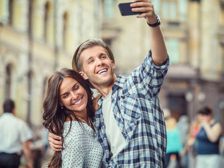 traveller: Young couple making selfie