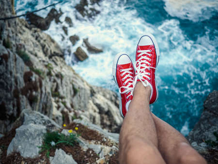 cliff edge: Mens feet on the cliff