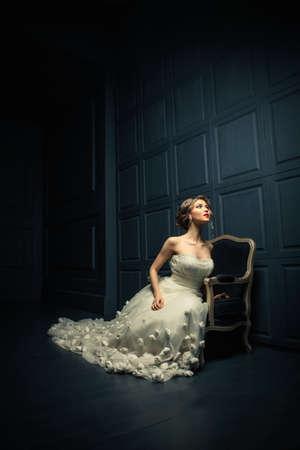 cinderella dress: Beautiful girl in a white dress in studio