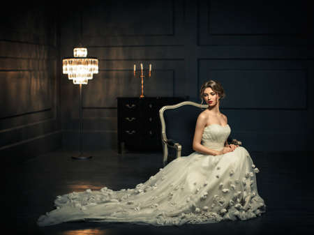 chandeliers: Young girl in a white dress