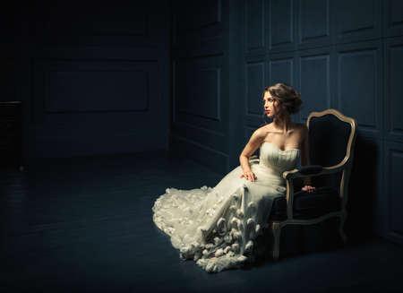 beautiful cinderella: Woman in a white dress in studio