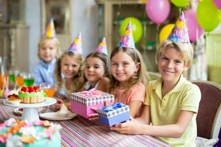 Smiling children at a birthday party