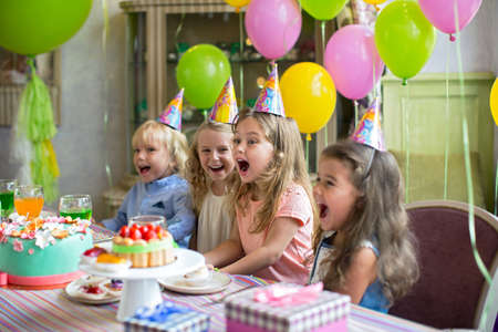 child food: Happy children at a birthday party
