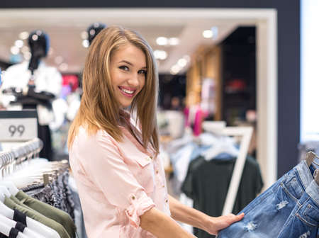 female clothing: Smiling girl in the store
