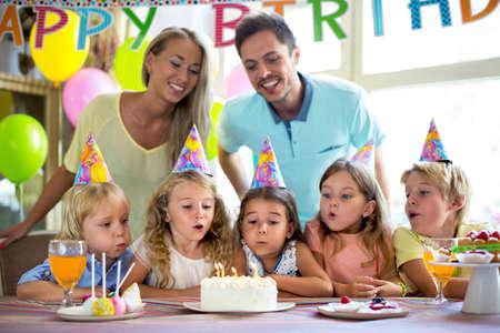 child birthday: Family celebrating a childs birthday Stock Photo