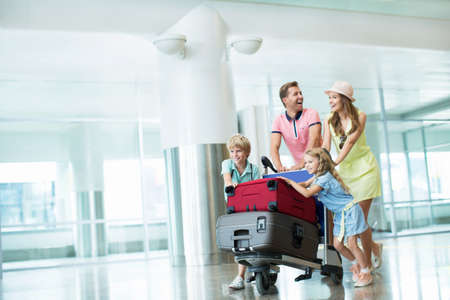 emotional couple: Family with a suitcase at the airport Stock Photo