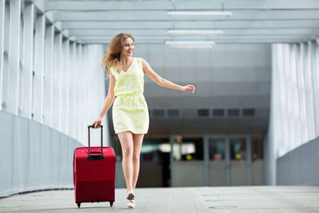 student travel: Young girl with a suitcase Stock Photo