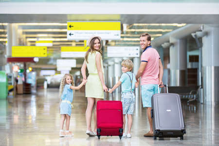 Family with children at the airport Stock Photo