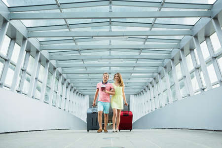 luggage travel: Young couple with a suitcase