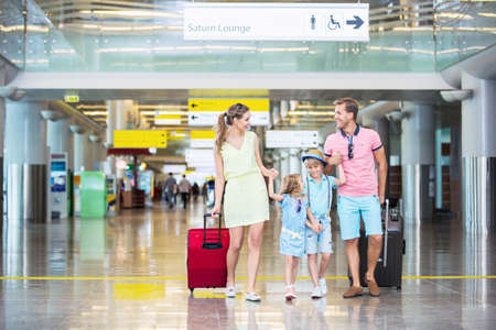 luggage travel: Family with children at the airport Stock Photo