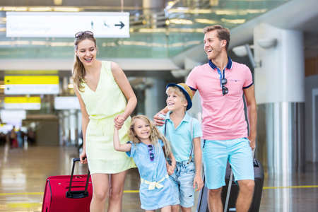 Smiling family with children at the airport