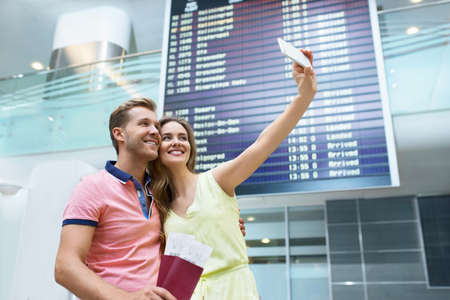 Young couple at the airport makes selfie