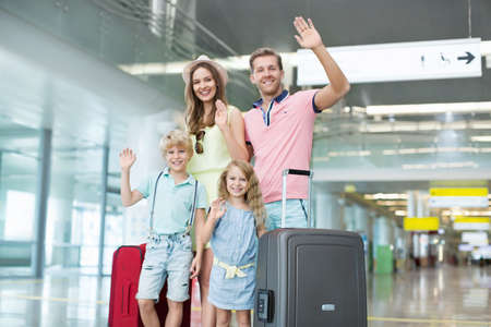 arrival: Family with luggage at the airport Stock Photo