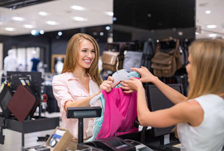 casual clothing: Woman at the checkout makes shopping Stock Photo