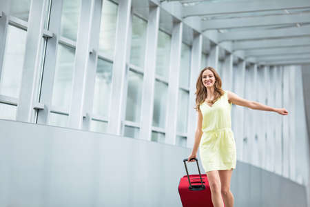 luggage travel: Attractive young girl with a suitcase